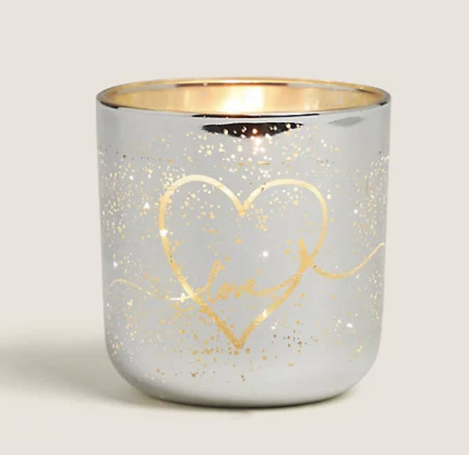 This candle votive lights up when it's lit, creating a beautiful effect