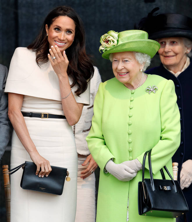 Meghan Markle relived a moment during a royal engagement with the Queen where she shared her blanket to keep her warm
