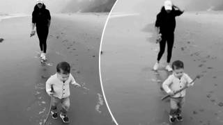 The couple shared an adorable video of Archie running along the beach