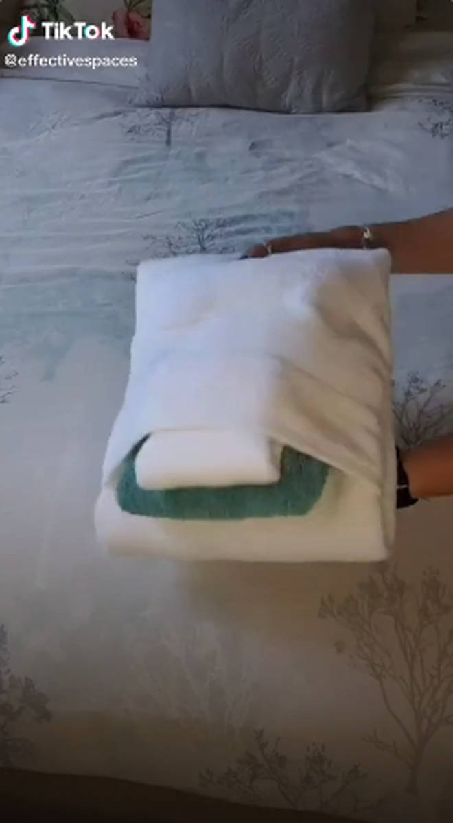 The woman unveils beautifully-folded towels