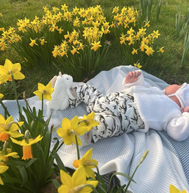 Baby August could be seen laying among the daffodils in the sweet Mother's Day post