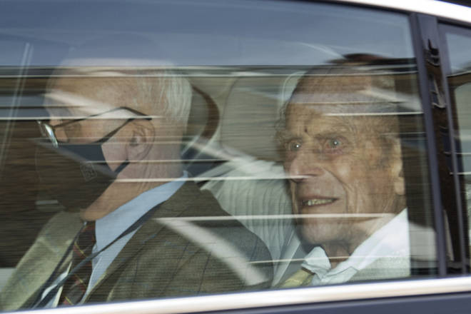 Prince Philip was seen getting into a black BMW, which then departed the hospital