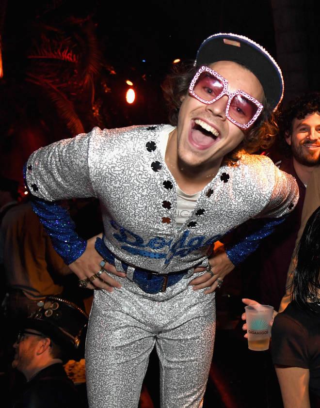 Harry Styles dresses as Elton John at the Casamigos Halloween Party