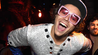 Harry Styles dresses as Elton John at the Casamigos Halloween Party