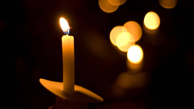 People are being encouraged to light candles for those who have died of Covid