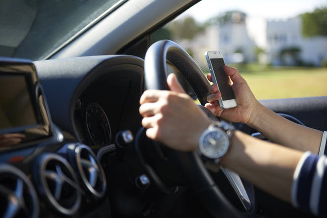 Drivers can now be penalised for holding their phones while driving in a bid to make roads safer