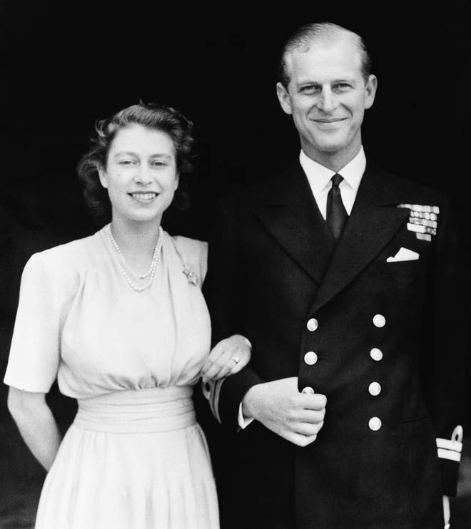 Prince Philip poses with Princess Elizabeth in July 1947. They were engaged at the time, and this photo was taken four months before their October wedding