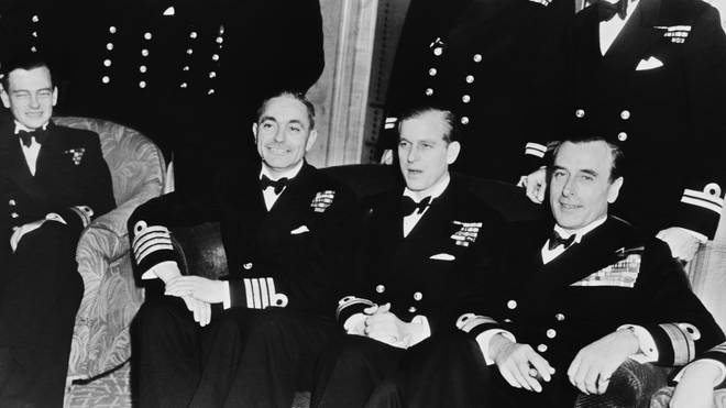 Prince Philip poses with fellow Navy Officers at his stag party on November 19 1947. The event took place at the Dorchester Hotel in London.