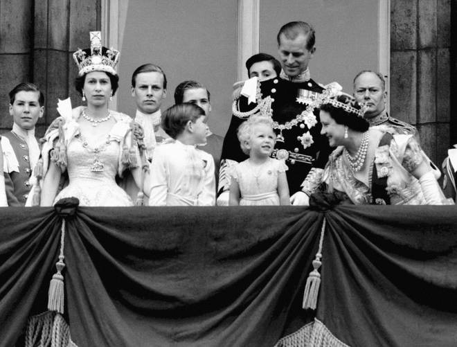 Queen Elizabeth II, Prince Charles, Princess Anne, the Duke of Edinburgh, the Queen Mother, and the Duke of Gloucester on the balcony of Buckingham Palace to watch the fly past of the Royal Air Force after the Coronation in 1953