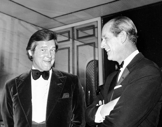 Prince Philip with actor Roger Moore at an auction dinner in aid of the Variety Club of Great Britain, at the Savoy Hotel, London.