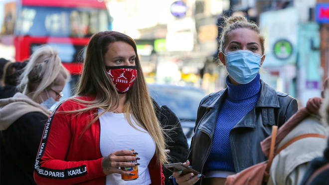 Face masks in England could remain for 'some time'