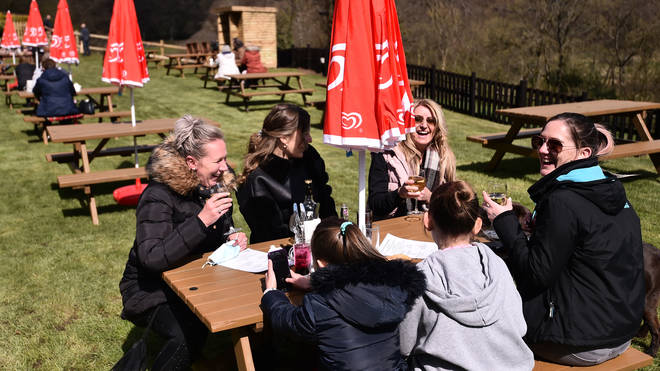 People in England flocked to pub gardens yesterday