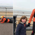 A  man has been hailed as a 'hero' after he lay down on the pavement to help an autistic boy