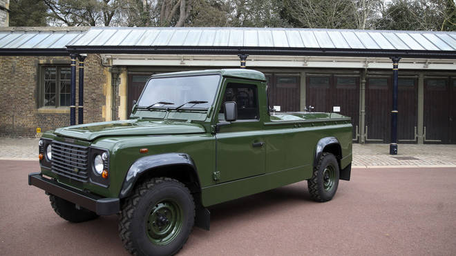 The car is a modified Land Rover Defender TD5 130 chassis cab vehicle