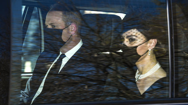Kate and William look sombre as they arrive at Windsor Castle for the funeral of Prince Philip