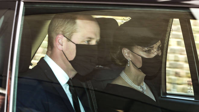Kate and William wear face masks as they arrive for the service