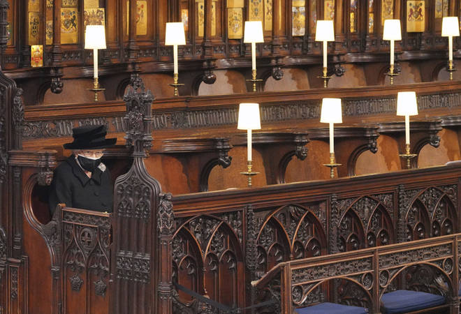 The Queen sits alone at St George's Chapel as the funeral begins