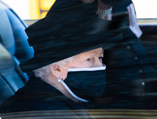 The Queen pictured in the back of the Royal Bentley travelling to her husband's funeral