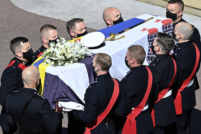 Pallbearers carry Prince Philip's coffin to St George's Chapel
