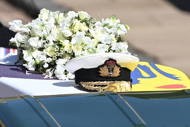 Prince Philip's Admiral of the Fleet naval cap sits on top of the coffin