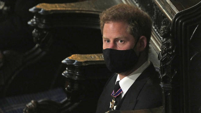 Prince Harry sits alone for the funeral service of the Duke of Edinburgh