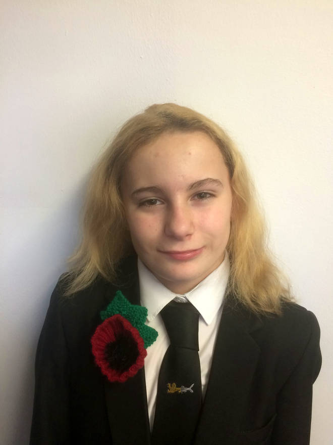 A student has been banned from wearing her oversized poppy
