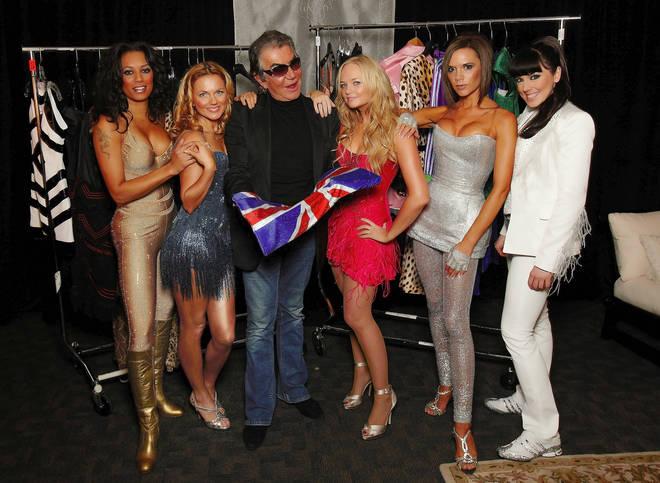 Spice Girls pose backstage with fashion designer Roberto Cavalli