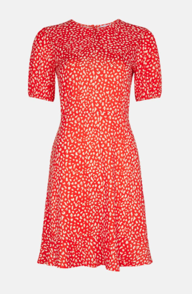 Holly Willoughby is wearing a red dress from Warehouse
