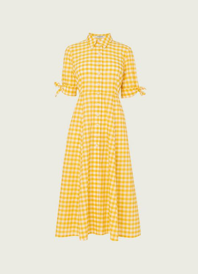 Holly Willoughby is wearing a yellow dress from LK Bennett