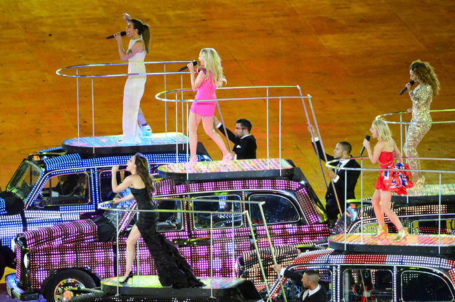 The Spice Girls perform on black cabs