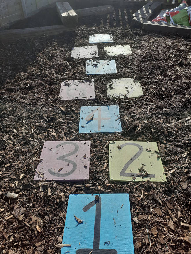 The parents created a Hopscotch game in the garden