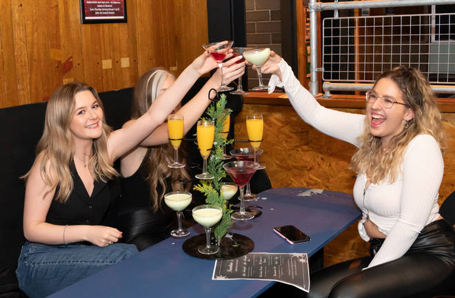 A group of women cheers their drinks in Showtime Bar in Huddersfield