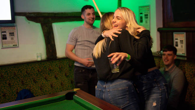 People in England are now allowed to hug again