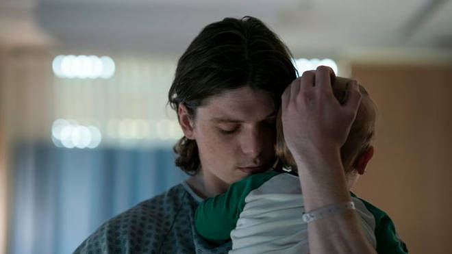 Dylan holding baby DJ in hospital