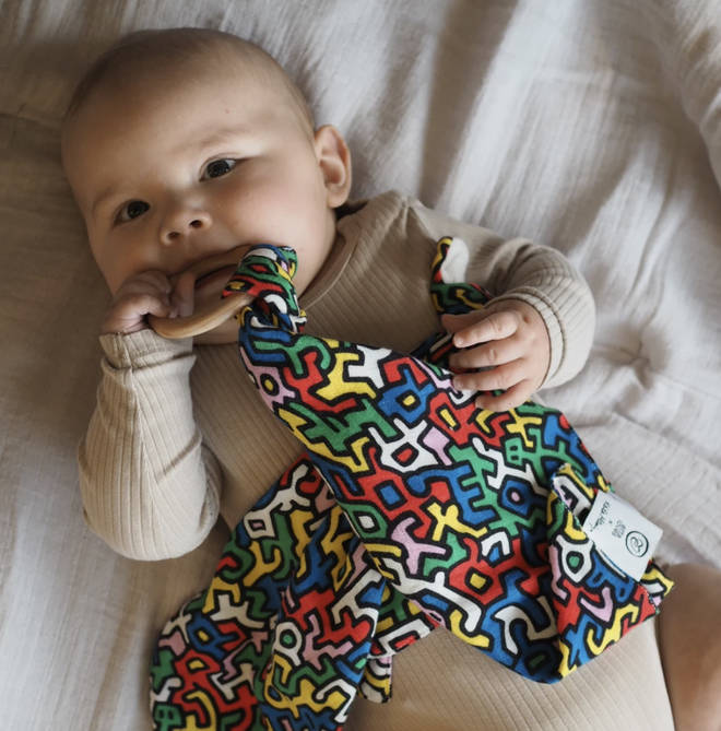 The baby sensory range features two of Keith Haring's most iconic prints