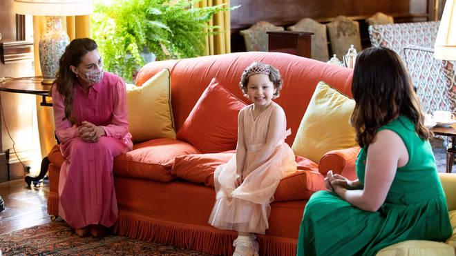 As promised, Kate Middleton wore a pink 'princess dress' to meet Mila this week