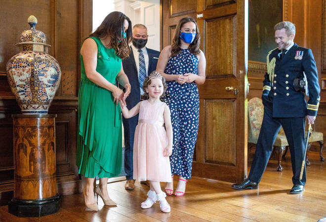 Mila and her family were invited to the Queen's Edinburgh home for the meeting