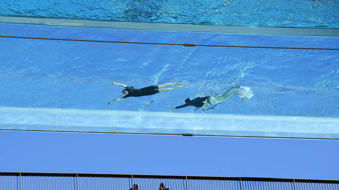 The pool has a glass bottom, which means swimmers can see the ground while taking a dip
