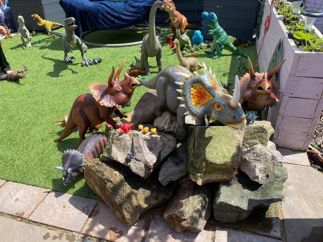 The garden contains an assortment of dinosaur toys