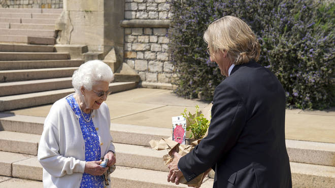 The Queen was handed a commemorative rose