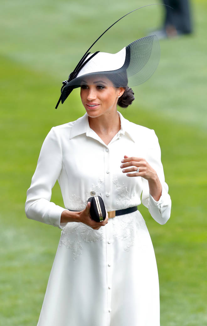 Meghan Markle looked stunning in a white shirt-dress by the same designer as her wedding dress, Givenchy