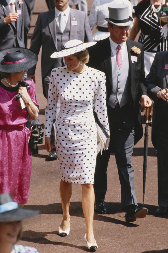 Princess Diana looked chic and classy in this navy and white polka dot dress, complete with matching hat