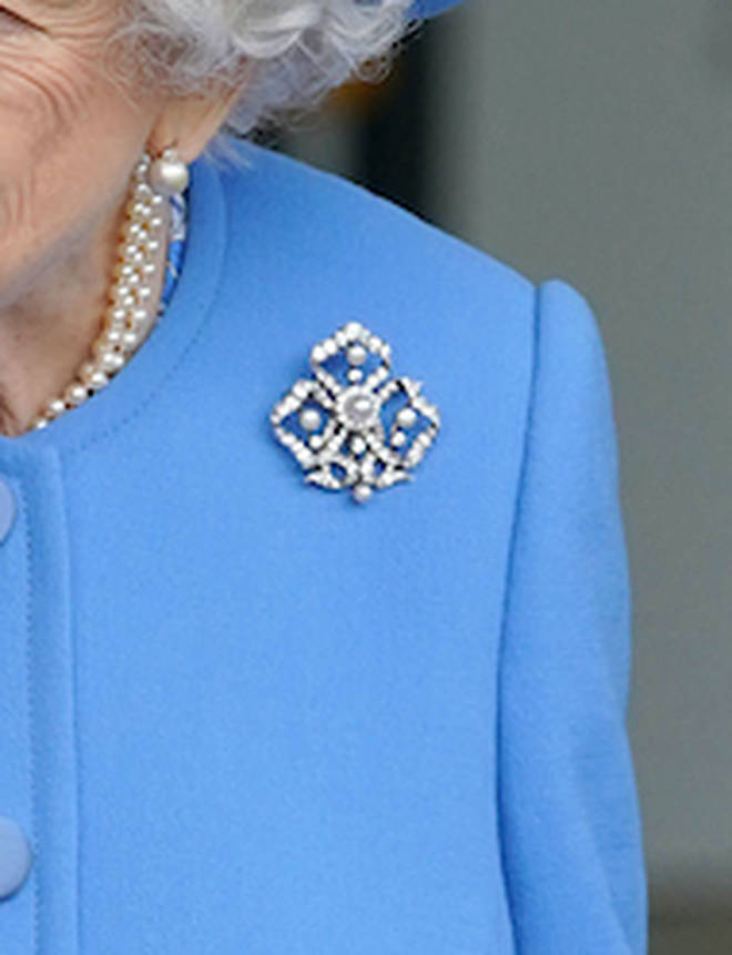The Pearl Trefoil Brooch is in the shape of the 'trinity knot' and is made up of diamonds and five pearls