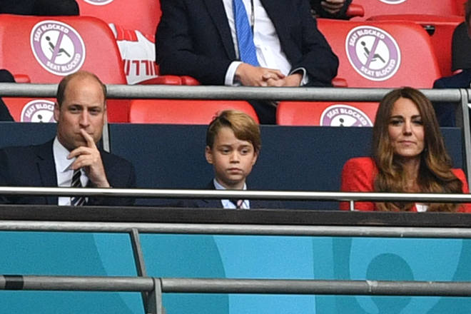 Prince George dressed in a suit and tie for the England versus Germany game