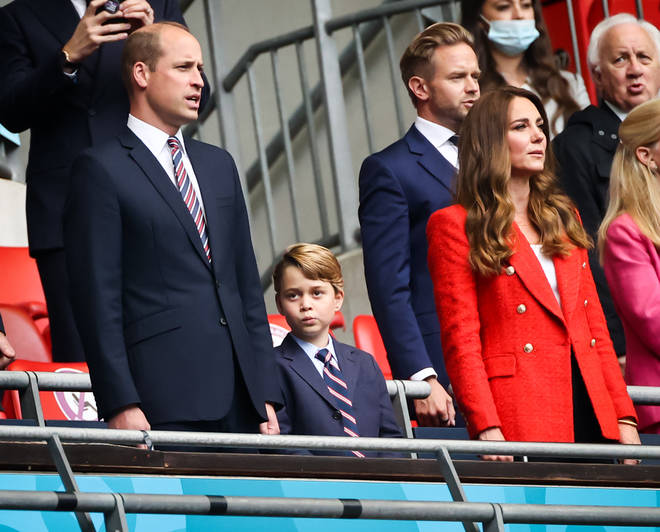Prince George didn't look too interested in singing the National Anthem with his parents