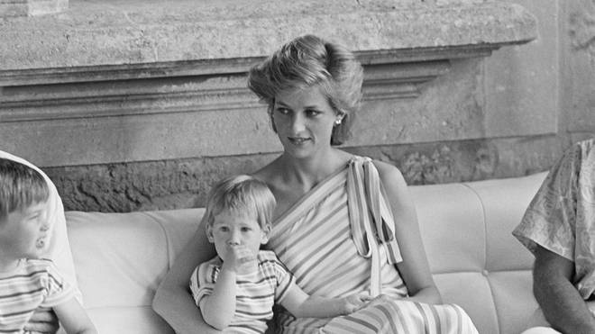 Diana holds Harry while visiting Majorca in 1986
