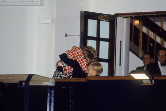 Diana hold William in a tight embrace as her sons join her on tour