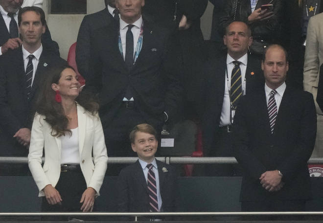 Prince George was seen in good spirits at the start of the match
