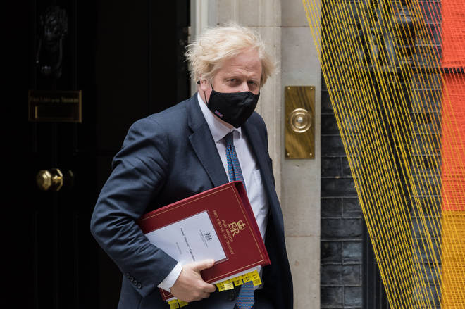 Boris Johnson has urged people to still wear face masks when in crowded spaces