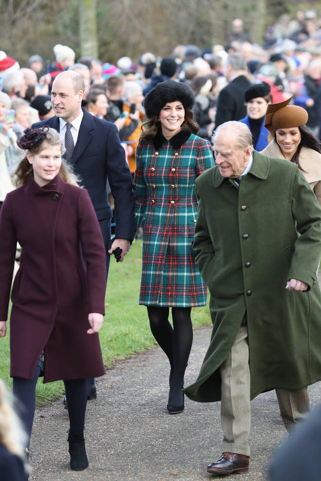 Kate and William hold hands as they walk to a Christmas Day Church Service together